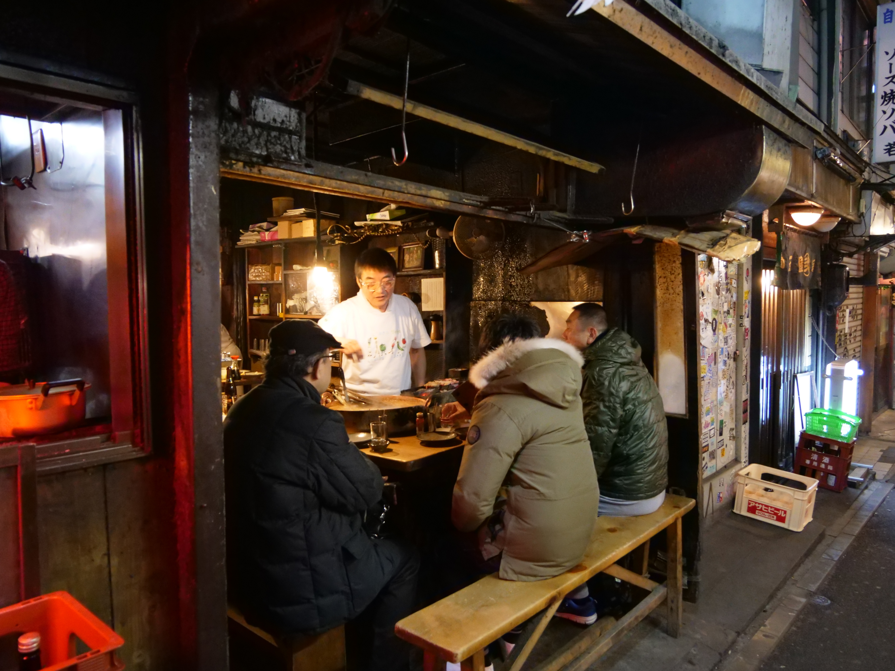 Locals drink in a izakaya after work